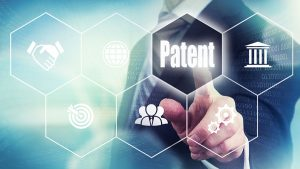 business person clicking patent button